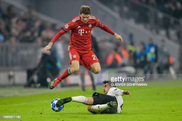 Bayern Munich's German forward Thomas Mueller and Benfica's Portuguese midfielder Gabriel vie for the ball during the UEFA Champions League Group E...