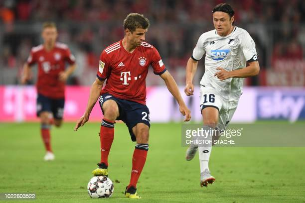 Bayern Munich's German forward Thomas Mueller and Hoffenheim's German defender Nico Schulz vie for the ball during the German first division...