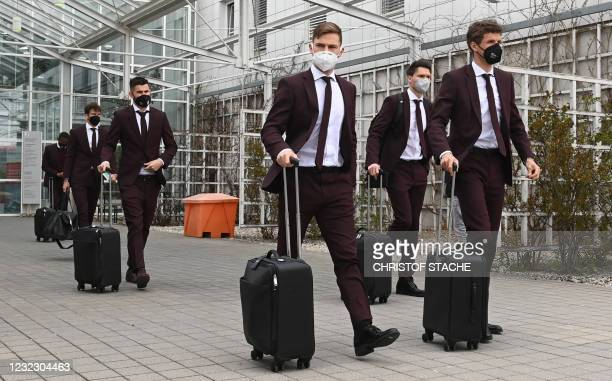 Bayern Munich's German forward Thomas Mueller , Bayern Munich's German midfielder Joshua Kimmich and other players leave the airport upon arrival in...