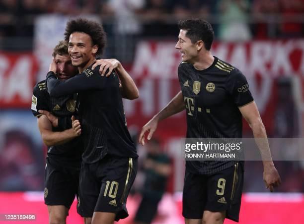 Bayern Munich's German forward Thomas Mueller, Bayern Munich's German midfielder Leroy Sane and Bayern Munich's Polish forward Robert Lewandowski...