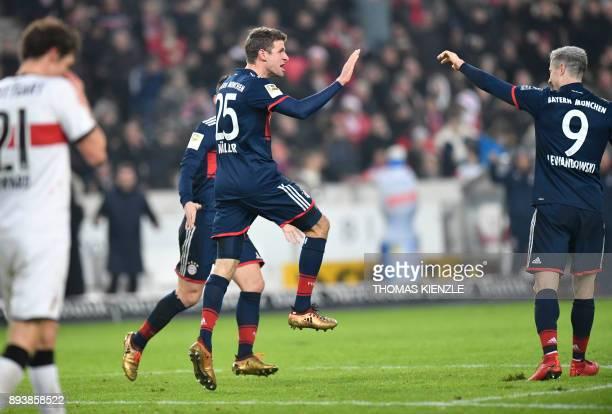 Bayern Munich's German forward Thomas Mueller celebrates after scoring during the German first division Bundesliga football match between VfB...