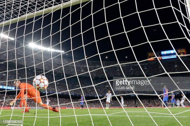 Bayern Munich's German forward Thomas Mueller celebrates his goal in front of Barcelona's German goalkeeper Marc-Andre ter Stegen during the UEFA...