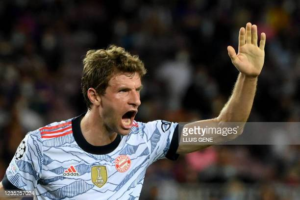Bayern Munich's German forward Thomas Mueller celebrates his goal during the UEFA Champions League first round group E football match between...