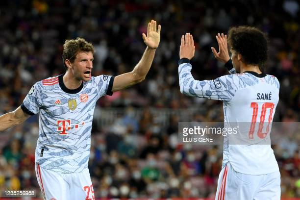 Bayern Munich's German forward Thomas Mueller celebrates his goal with Bayern Munich's German midfielder Leroy Sane during the UEFA Champions League...