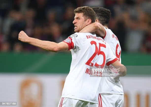 Bayern Munich's German forward Thomas Mueller celebrates next to Bayern Munich's Polish forward Robert Lewandowski after scoring during the German...