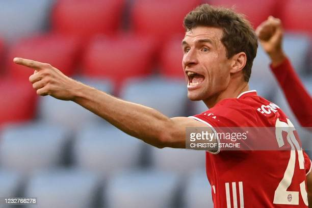 Bayern Munich's German forward Thomas Mueller celebrates scoring the 2-0 goal with his team-mates during the German first division Bundesliga...