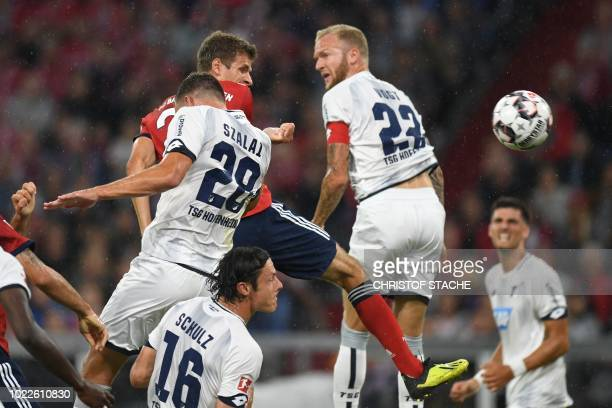 Bayern Munich's German forward Thomas Mueller heads in the opening goal of the season during the German first division Bundesliga football match FC...