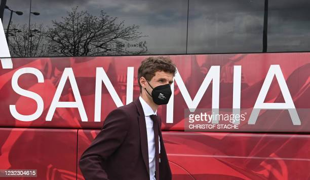 Bayern Munich's German forward Thomas Mueller leaves the airport upon arrival in Munich, southern Germany, on April 14, 2021 as the FC Bayern Munich...