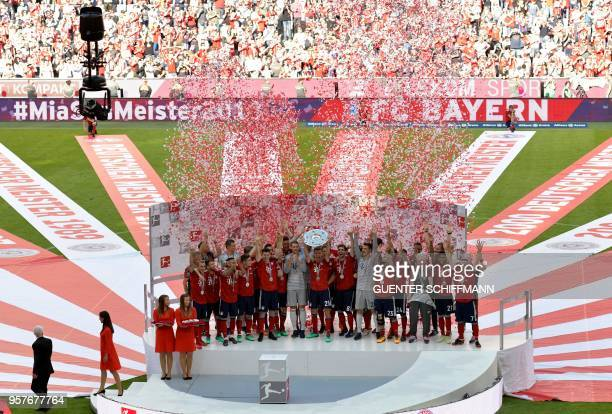 TOPSHOT Bayern Munich's German forward Thomas Mueller lifts the trophy during the celebration for the 28th German football championship after the...