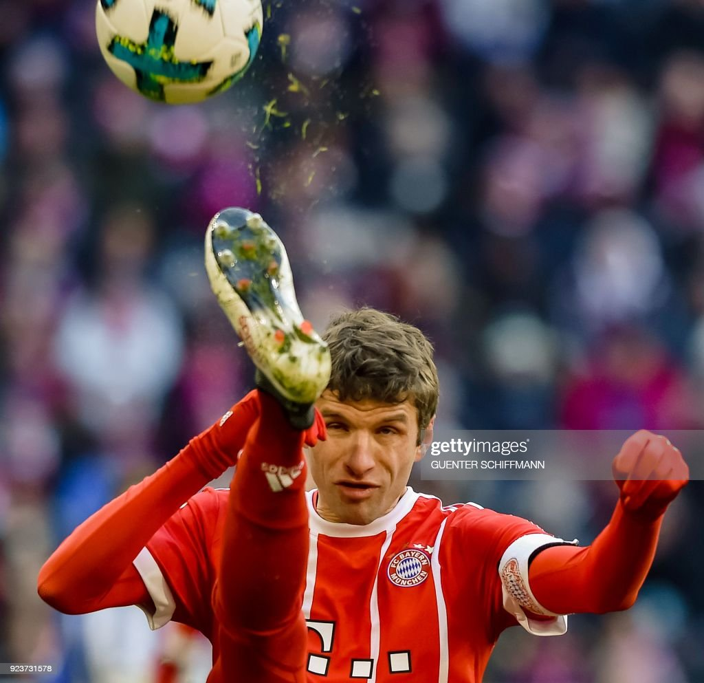 Bayern Munich's German forward Thomas Mueller plays the ball during the German first division Bundesliga football match Bayern Munich vs Hertha Berlin in Munich, southern Germany, on February 24, 2018. / AFP PHOTO / Guenter