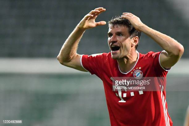 Bayern Munich's German forward Thomas Mueller reacts after a missed scoring opportunity during the German first division Bundesliga football match SV...