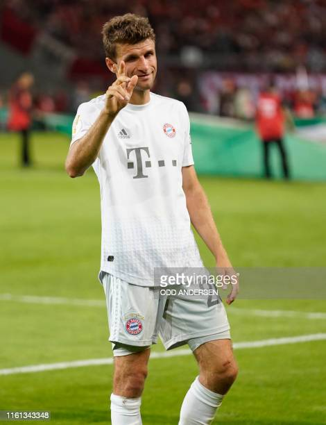 Bayern Munich's German forward Thomas Mueller reacts after the German Cup first round football match FC Energie Cottbus v FC Bayern Munich at the...