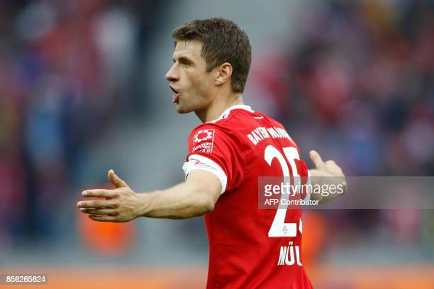 Bayern Munich's German forward Thomas Mueller reacts during the German first division Bundesliga football match between Hertha Berlin and FC Bayern...