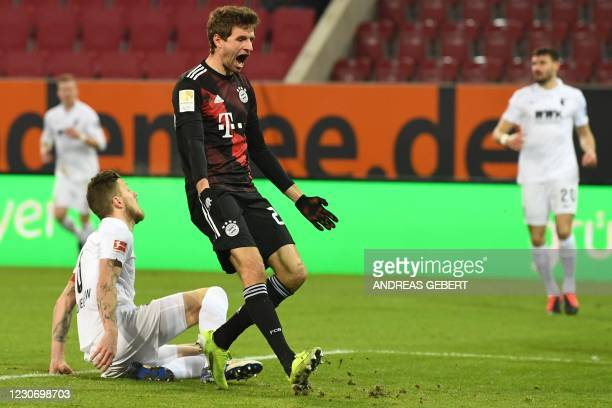 Bayern Munich's German forward Thomas Mueller reacts to a missed chance during the German first division football Bundesliga match FC Augsburg v FC...