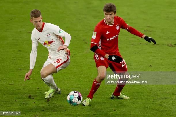 Bayern Munich's German forward Thomas Mueller vies for the ball during the German first division Bundesliga football match FC Bayern Munich v RB...