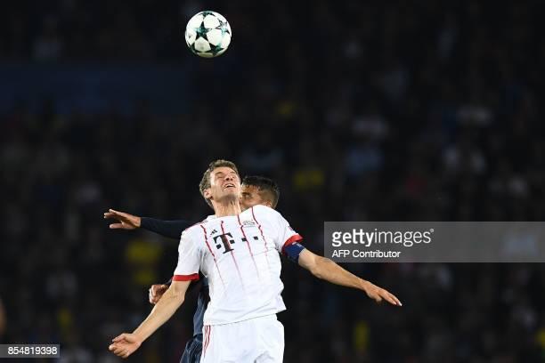 Bayern Munich's German forward Thomas Mueller vies with Paris SaintGermain's Brazilian defender Thiago Silva during the UEFA Champions League...