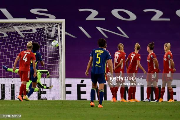 Bayern Munich's German goalkeeper Laura Benkarth concedes a second goal scored by Lyon's French midfielder Amel Majri during the UEFA Women's...