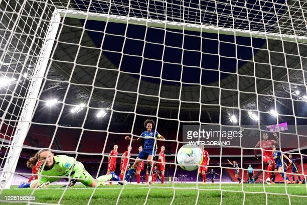Bayern Munich's German goalkeeper Laura Benkarth concedes a second goal during the UEFA Women's Champions League quarter-final football match between...