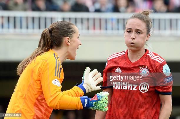 Bayern Munich's German goalkeeper Laura Benkarth talks to Bayern Munich's US defender Gina Lewandowski during the UEFA Women's Champions League...