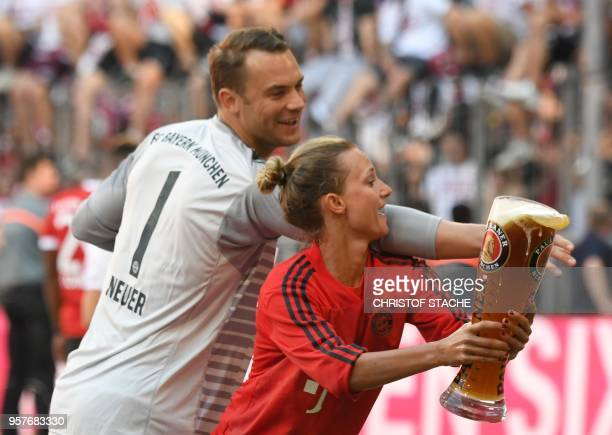 Bayern Munich's German goalkeeper Manuel Neuer and an assistant joke during the celebration for the 28th German football championship after the...