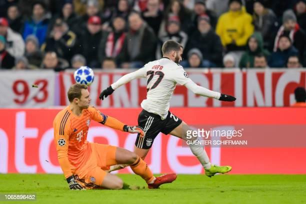 Bayern Munich's German goalkeeper Manuel Neuer and Benfica's Portuguese forward Rafa Silva vie for the ball during the UEFA Champions League Group E...