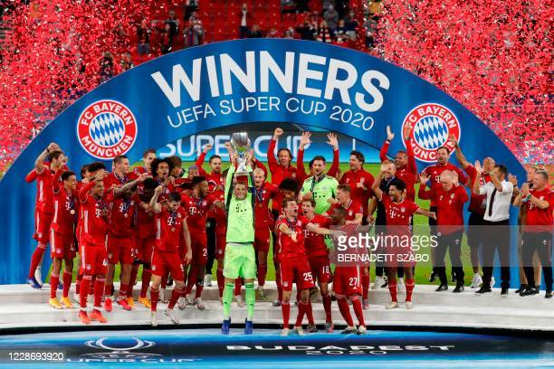 Bayern Munich's German goalkeeper Manuel Neuer and his teammates celebrate with the trophy after the UEFA Super Cup football match between FC Bayern...
