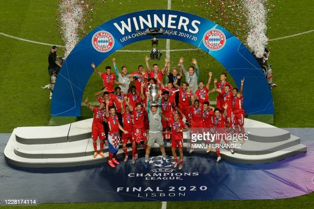 Bayern Munich's German goalkeeper Manuel Neuer and teammates celebrate with the trophy after winning the UEFA Champions League final football match...