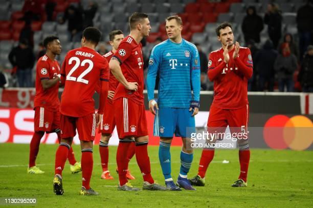 Bayern Munich's German goalkeeper Manuel Neuer and teammates react after the UEFA Champions League last 16 second leg football match Bayern Munich v...