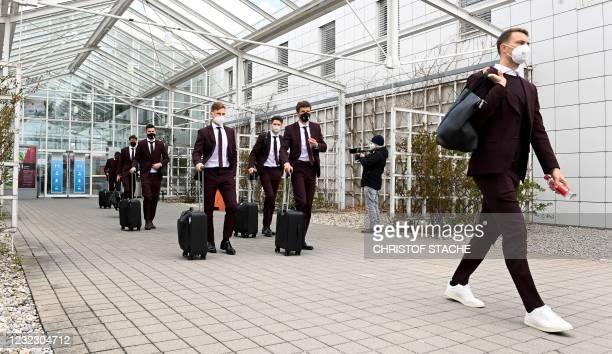 Bayern Munich's German goalkeeper Manuel Neuer , Bayern Munich's German forward Thomas Mueller , Bayern Munich's German midfielder Joshua Kimmich and...