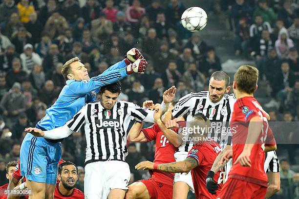 Bayern Munich's German goalkeeper Manuel Neuer blocks a shot on goal by Juventus' Spanish forward Alvaro Morata during the UEFA Champions League...