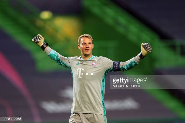 Bayern Munich's German goalkeeper Manuel Neuer celebrates his team's third goal during the UEFA Champions League semifinal football match between...