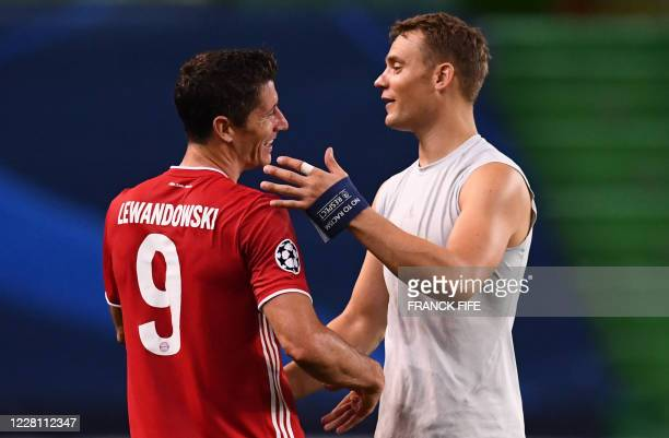 Bayern Munich's German goalkeeper Manuel Neuer celebrates with Bayern Munich's Polish forward Robert Lewandowski at the end of the UEFA Champions...
