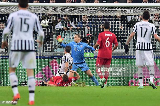 Bayern Munich's German goalkeeper Manuel Neuer concedes a goal to Juventus' Italian midfielder Stefano Sturaro during the UEFA Champions League round...