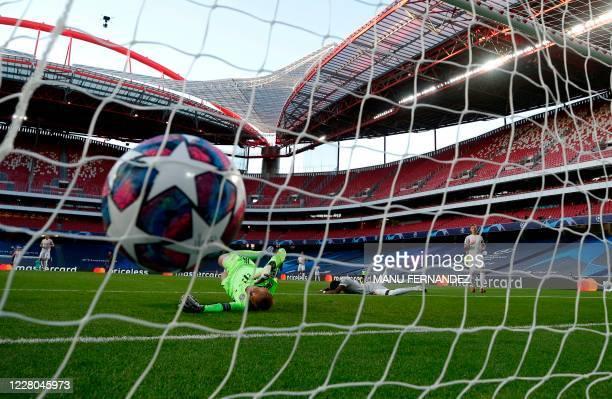 Bayern Munich's German goalkeeper Manuel Neuer concedes an own goal during the UEFA Champions League quarterfinal football match between Barcelona...