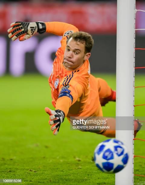 Bayern Munich's German goalkeeper Manuel Neuer dives for the ball during the UEFA Champions League Group E football match Bayern Munich vs Benfica...