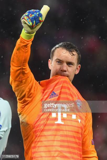 Bayern Munich's German goalkeeper Manuel Neuer gestures to supporters on the pitch after the UEFA Champions League round of 16 first leg football...