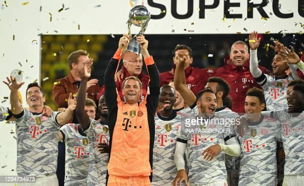 Bayern Munich's German goalkeeper Manuel Neuer lifts the trophy after the German Supercup football match BVB Borussia Dortmund vs FC Bayern Munich in...