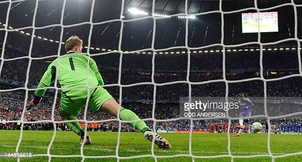 Bayern Munich's German goalkeeper Manuel Neuer misses to catch the ball as Chelsea's Ivorian forward Didier Drogba scores during the penalty phase of...
