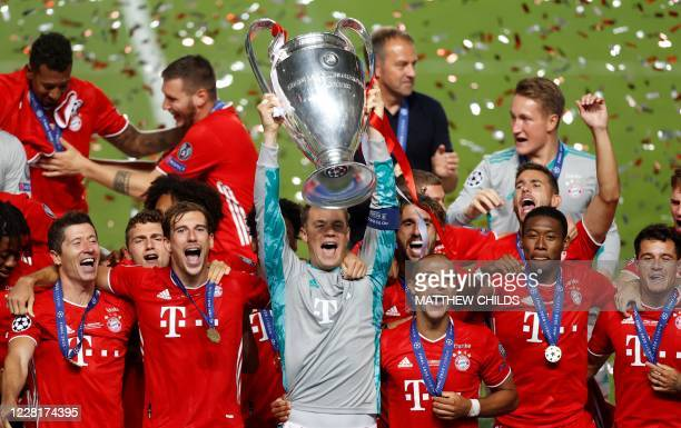 Bayern Munich's German goalkeeper Manuel Neuer raises the European Champion Clubs' Cup during the trophy ceremony after winning at the end of the...