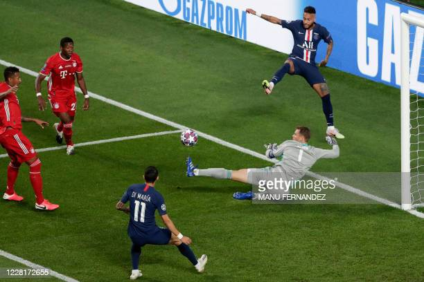 TOPSHOT Bayern Munich's German goalkeeper Manuel Neuer saves a shot from Paris SaintGermain's Brazilian forward Neymar during the UEFA Champions...