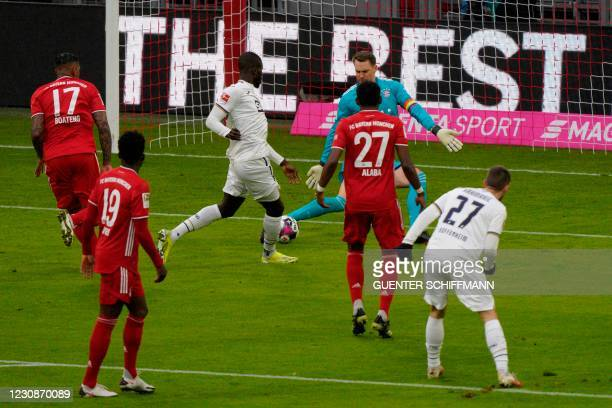 Bayern Munich's German goalkeeper Manuel Neuer saves the ball from Hoffenheim's Togolese forward Ihlas Bebou during the German first division...