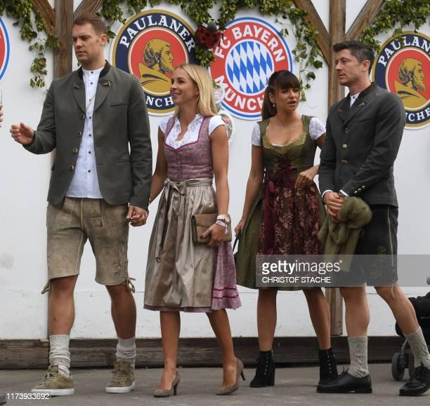 Bayern Munich's German goalkeeper Manuel Neuer with his wife Nina Neuer and Bayern Munich's Polish forward Robert Lewandowski and his wife Anna...