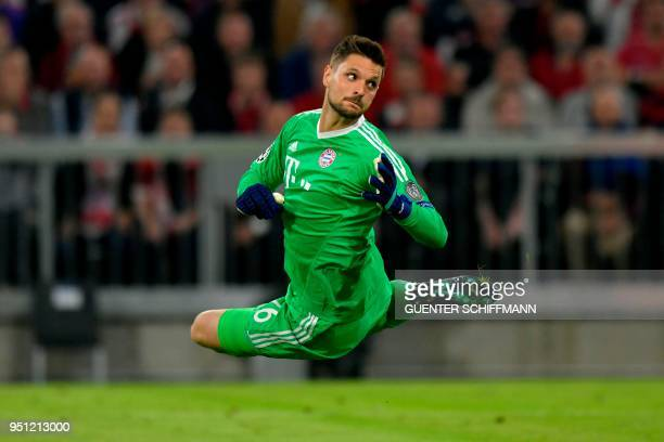 TOPSHOT Bayern Munich's German goalkeeper Sven Ulreich eyes the ball that he failed to stop during the UEFA Champions League semifinal firstleg...
