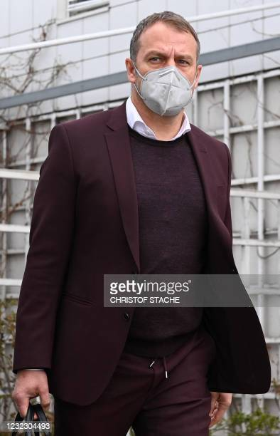 Bayern Munich's German head coach Hans-Dieter Flick leaves the airport upon arrival in Munich, southern Germany, on April 14, 2021 as the FC Bayern...