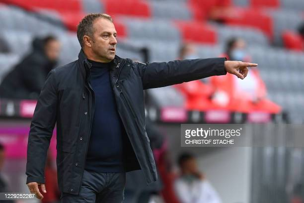 Bayern Munich's German head coach Hans-Dieter Flick reacts from the sidelines during the German first division Bundesliga football match between FC...