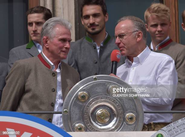 Bayern Munich's German head coach Jupp Heynckes and Bayern Munich's chief executive officer Karl Heinz Rummenigge celebrate on the balcony of the...