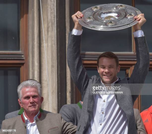 Bayern Munich's German head coach Jupp Heynckes and Bayern Munich's German goalkeeper Manuel Neuer celebrate with the Bundesliga trophy on the...