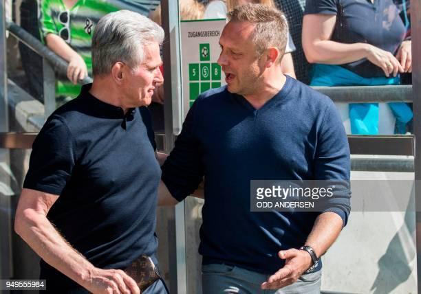 Bayern Munich's German head coach Jupp Heynckes and Hanover's German head coach Andre Breitenreiter talk ahead the German first division Bundesliga...