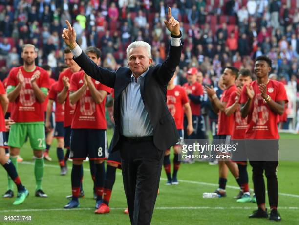 Bayern Munich's German head coach Jupp Heynckes and his players celebrate after the German first division Bundesliga football match 1 FC Augsburg vs...