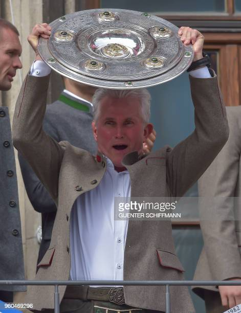 Bayern Munich's German head coach Jupp Heynckes and his players celebrate on the balcony of the city hall in Munich southern Germany on May 20 2018
